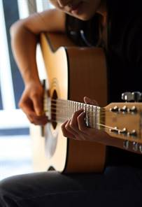 A woman playing guitar